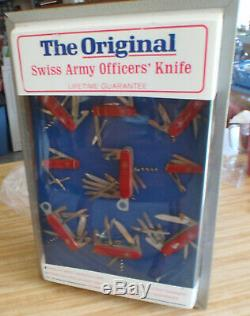 The Original Display Cabinet With Nine Swiss Army Knives All Sizes